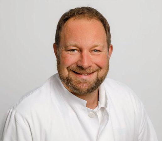 Dr. Götz Senska